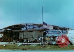 Image of damaged German hangar and USAAF P47 Thunderbolts Germany, 1945, second 5 stock footage video 65675020424