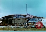 Image of damaged German hangar and USAAF P47 Thunderbolts Germany, 1945, second 16 stock footage video 65675020424