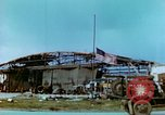 Image of damaged German hangar and USAAF P47 Thunderbolts Germany, 1945, second 25 stock footage video 65675020424