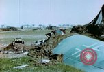 Image of Camouflaged wrecked German Heinkel He-111 airplanes Germany, 1945, second 26 stock footage video 65675020427