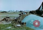 Image of Camouflaged wrecked German Heinkel He-111 airplanes Germany, 1945, second 30 stock footage video 65675020427