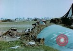 Image of Camouflaged wrecked German Heinkel He-111 airplanes Germany, 1945, second 31 stock footage video 65675020427