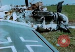 Image of Camouflaged wrecked German Heinkel He-111 airplanes Germany, 1945, second 60 stock footage video 65675020427
