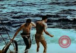 Image of Amphibious task force Pacific Theater, 1944, second 5 stock footage video 65675020458