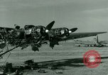 Image of Wreckage of German Me-323 transport airplane at El Aouina airfield Tunis Tunisia, 1943, second 14 stock footage video 65675020479