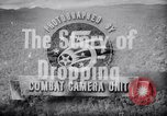 Image of dropping supplies Papua New Guinea, 1944, second 29 stock footage video 65675020560