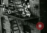 Image of Residents outdoors in their neighborhood Bronx New York City USA, 1965, second 23 stock footage video 65675020823