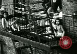 Image of Residents outdoors in their neighborhood Bronx New York City USA, 1965, second 26 stock footage video 65675020823