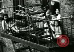 Image of Residents outdoors in their neighborhood Bronx New York City USA, 1965, second 27 stock footage video 65675020823