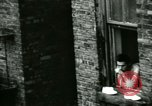 Image of Residents outdoors in their neighborhood Bronx New York City USA, 1965, second 30 stock footage video 65675020823