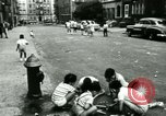 Image of Residents outdoors in their neighborhood Bronx New York City USA, 1965, second 57 stock footage video 65675020823