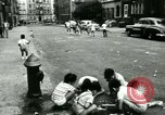 Image of Residents outdoors in their neighborhood Bronx New York City USA, 1965, second 58 stock footage video 65675020823