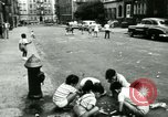 Image of Residents outdoors in their neighborhood Bronx New York City USA, 1965, second 59 stock footage video 65675020823