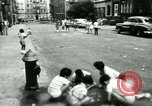 Image of Residents outdoors in their neighborhood Bronx New York City USA, 1965, second 60 stock footage video 65675020823