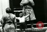 Image of Residents outdoors in their neighborhood Bronx New York City USA, 1965, second 61 stock footage video 65675020823