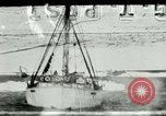 Image of Captain Pedersen of Whaler Herman trades with Eskimos Indian Point Alaska USA, 1915, second 1 stock footage video 65675020846