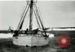 Image of Captain Pedersen of Whaler Herman trades with Eskimos Indian Point Alaska USA, 1915, second 5 stock footage video 65675020846