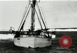 Image of Captain Pedersen of Whaler Herman trades with Eskimos Indian Point Alaska USA, 1915, second 6 stock footage video 65675020846