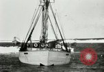 Image of Captain Pedersen of Whaler Herman trades with Eskimos Indian Point Alaska USA, 1915, second 7 stock footage video 65675020846