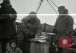 Image of Captain Pedersen of Whaler Herman trades with Eskimos Indian Point Alaska USA, 1915, second 15 stock footage video 65675020846