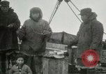Image of Captain Pedersen of Whaler Herman trades with Eskimos Indian Point Alaska USA, 1915, second 19 stock footage video 65675020846