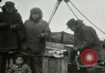 Image of Captain Pedersen of Whaler Herman trades with Eskimos Indian Point Alaska USA, 1915, second 20 stock footage video 65675020846
