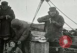 Image of Captain Pedersen of Whaler Herman trades with Eskimos Indian Point Alaska USA, 1915, second 23 stock footage video 65675020846