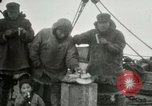 Image of Captain Pedersen of Whaler Herman trades with Eskimos Indian Point Alaska USA, 1915, second 24 stock footage video 65675020846