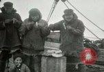 Image of Captain Pedersen of Whaler Herman trades with Eskimos Indian Point Alaska USA, 1915, second 25 stock footage video 65675020846