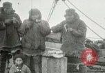 Image of Captain Pedersen of Whaler Herman trades with Eskimos Indian Point Alaska USA, 1915, second 26 stock footage video 65675020846