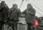 Image of Captain Pedersen of Whaler Herman trades with Eskimos Indian Point Alaska USA, 1915, second 27 stock footage video 65675020846