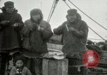 Image of Captain Pedersen of Whaler Herman trades with Eskimos Indian Point Alaska USA, 1915, second 28 stock footage video 65675020846