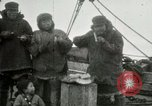 Image of Captain Pedersen of Whaler Herman trades with Eskimos Indian Point Alaska USA, 1915, second 29 stock footage video 65675020846