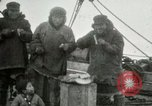 Image of Captain Pedersen of Whaler Herman trades with Eskimos Indian Point Alaska USA, 1915, second 30 stock footage video 65675020846