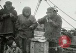 Image of Captain Pedersen of Whaler Herman trades with Eskimos Indian Point Alaska USA, 1915, second 31 stock footage video 65675020846