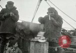 Image of Captain Pedersen of Whaler Herman trades with Eskimos Indian Point Alaska USA, 1915, second 32 stock footage video 65675020846
