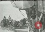 Image of Captain Pedersen of Whaler Herman trades with Eskimos Indian Point Alaska USA, 1915, second 46 stock footage video 65675020846