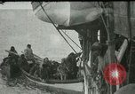 Image of Captain Pedersen of Whaler Herman trades with Eskimos Indian Point Alaska USA, 1915, second 47 stock footage video 65675020846