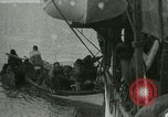 Image of Captain Pedersen of Whaler Herman trades with Eskimos Indian Point Alaska USA, 1915, second 49 stock footage video 65675020846