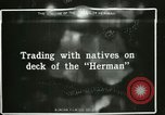 Image of Captain Pedersen of Whaler Herman trades with Eskimos Indian Point Alaska USA, 1915, second 59 stock footage video 65675020846