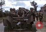Image of Allied troops advancing through ruins and beach obstacles Valognes France, 1944, second 1 stock footage video 65675020907