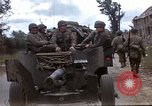 Image of Allied troops advancing through ruins and beach obstacles Valognes France, 1944, second 2 stock footage video 65675020907
