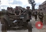 Image of Allied troops advancing through ruins and beach obstacles Valognes France, 1944, second 3 stock footage video 65675020907