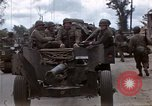 Image of Allied troops advancing through ruins and beach obstacles Valognes France, 1944, second 6 stock footage video 65675020907