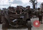 Image of Allied troops advancing through ruins and beach obstacles Valognes France, 1944, second 7 stock footage video 65675020907