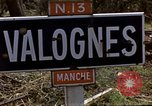 Image of Allied troops advancing through ruins and beach obstacles Valognes France, 1944, second 9 stock footage video 65675020907