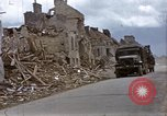 Image of Allied troops advancing through ruins and beach obstacles Valognes France, 1944, second 14 stock footage video 65675020907