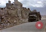 Image of Allied troops advancing through ruins and beach obstacles Valognes France, 1944, second 15 stock footage video 65675020907