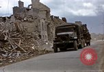 Image of Allied troops advancing through ruins and beach obstacles Valognes France, 1944, second 16 stock footage video 65675020907