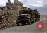 Image of Allied troops advancing through ruins and beach obstacles Valognes France, 1944, second 17 stock footage video 65675020907